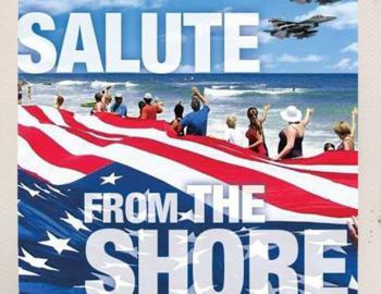 People saluting air force from the shores