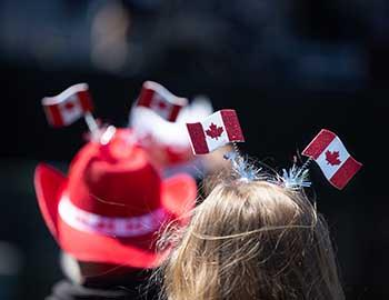 People wearing Canadian flag hats