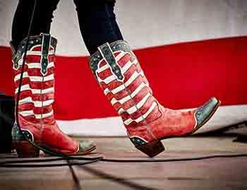 Girl wearing American flag cowboy boots on stage