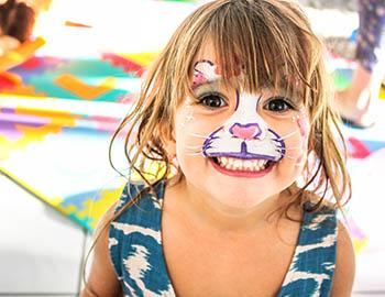 Little girl with cat face paint on