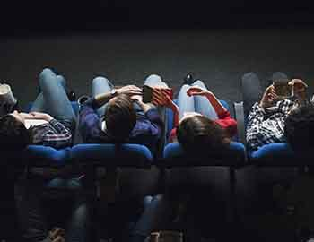 Ariel shot of people in the front row at the theatre