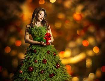 Woman dressed up as a Christmas tree