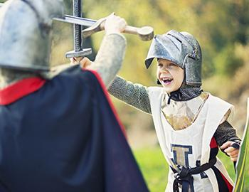 Little kid dressed up as a knight on halloween