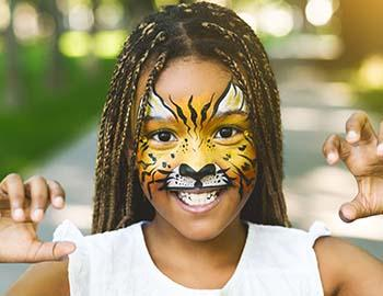 Little girl with tiger facepaint on