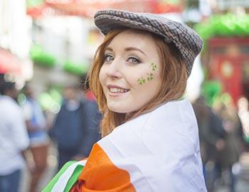 Irish girl smiling with clover face stickers