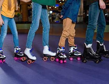 kids roller skating together at the skate rink