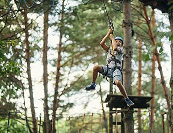 Young boy enjoying a zip line adventure