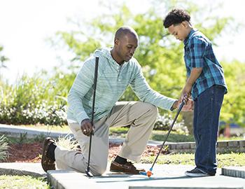 Father and son at mini golf